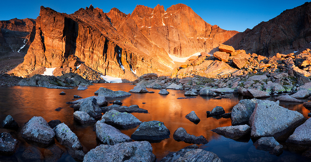 Located about halfway up 14,259' Longs Peak, Chasm Lake reflects morning alpenglow from the sheer granite rock face known as The Diamond.