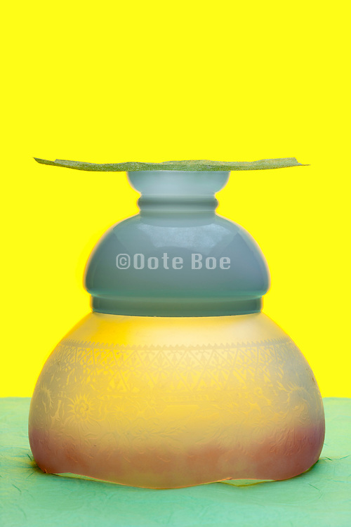 antique lamp shades objects stacked on top of each other on yellow green background