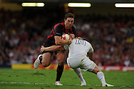 George North of Wales is tackled by England's Mike Tindall. Wales v England, international rugby, World cup warm up match at Millennium Stadium in Cardiff on Sat 13th August 2011. Pic By Andrew Orchard, Andrew Orchard sports photography,