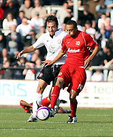 Photo: Mark Stephenson.<br /> Hereford United v Milton Keynes Dons. Coca Cola League 2. 20/10/2007.M K Don's Mark Wright on the ball from Hereford's Clint Easton