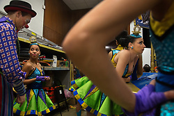 """Performers relax backstage between acts in Washington D.C.<br /> Ringling Bros. and Barnum & Bailey Circus started in 1919 when the circus created by James Anthony Bailey and P. T. Barnum merged with the Ringling Brothers Circus. Currently, the circus maintains two circus train-based shows, the Blue Tour and the Red Tour, as well as the truck-based Gold Tour. Each train is a mile long with roughly 60 cars: 40 passenger cars and 20 freight. Each train presents a different """"edition"""" of the show, using a numbering scheme that dates back to circus origins in 1871 — the first year of P.T. Barnum's show."""