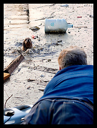 5th Sept, 2005. Hurricane Katrina aftermath. Animal rescue boat. William Jones hauls a dog from the water in Uptown New Orleans as he sweeps the area with friends looking for people or animals to rescue.