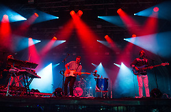 Tommy Grace, Vincent Neff and Jimmy Dixon of Django Django perform on stage on day 1 of Standon Calling Festival on July 27, 2018 in Standon, England. Picture date: Friday 27 July, 2018. Photo credit: Katja Ogrin/ EMPICS Entertainment.