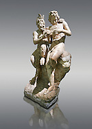 2nd century AD Roman marble sculpture of Pan teaching Daphnis to play the pipes, a Roman copy late 2nd century BC Hellenistic Geek original attributed to Rodes sculptor Heliodoros. Pan's and Daphnis' heads and Daphnis' right arm are restorations.  The Farnese collection, Naples Museum of Archaeology, Italy .<br /> <br /> If you prefer to buy from our ALAMY STOCK LIBRARY page at https://www.alamy.com/portfolio/paul-williams-funkystock/greco-roman-sculptures.html . Type -    Naples    - into LOWER SEARCH WITHIN GALLERY box - Refine search by adding a subject, place, background colour, etc.<br /> <br /> Visit our ROMAN WORLD PHOTO COLLECTIONS for more photos to download or buy as wall art prints https://funkystock.photoshelter.com/gallery-collection/The-Romans-Art-Artefacts-Antiquities-Historic-Sites-Pictures-Images/C0000r2uLJJo9_s0