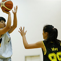Juliana Ang (#19) of Singapore Institute of Management shoots the ball against (#99) of Singapore Polytechnic. (Photo © Lim Yong Teck/Red Sports)
