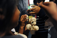 Hanging tiny skulls at the Cesar Chavez Library before Halloween.