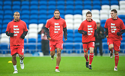 CARDIFF, WALES - Saturday, November 14, 2009: Wales players warm-up wearing 'Show Racism the Red Card' before the international friendly match against Scotland at the Cardiff City Stadium. L-R: Jermaine Easter, captain Ashley Williams, Joe Allen and Andy Dorman. (Pic by David Rawcliffe/Propaganda)