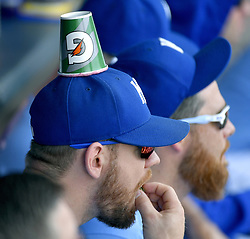 August 20, 2017 - Kansas City, MO, USA - Kansas City Royals' Brandon Moss sits in the dugout with a cup stuck to his hat during a baseball game against the Cleveland Indians on Sunday, Aug. 20, 2017 at Kauffman Stadium in Kansas City, Mo. (Credit Image: © John Sleezer/TNS via ZUMA Wire)