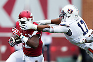 FAYETTEVILLE, AR - OCTOBER 24:  Rawleigh Williams III #22 of the Arkansas Razorbacks is tackled by the face mask by Kris Frost #17 of the Auburn Tigers at Razorback Stadium Stadium on October 24, 2015 in Fayetteville, Arkansas.  The Razorbacks defeated the Tigers in 4 OT's 54-46.  (Photo by Wesley Hitt/Getty Images) *** Local Caption *** Rawleigh Williams III; Kris Frost