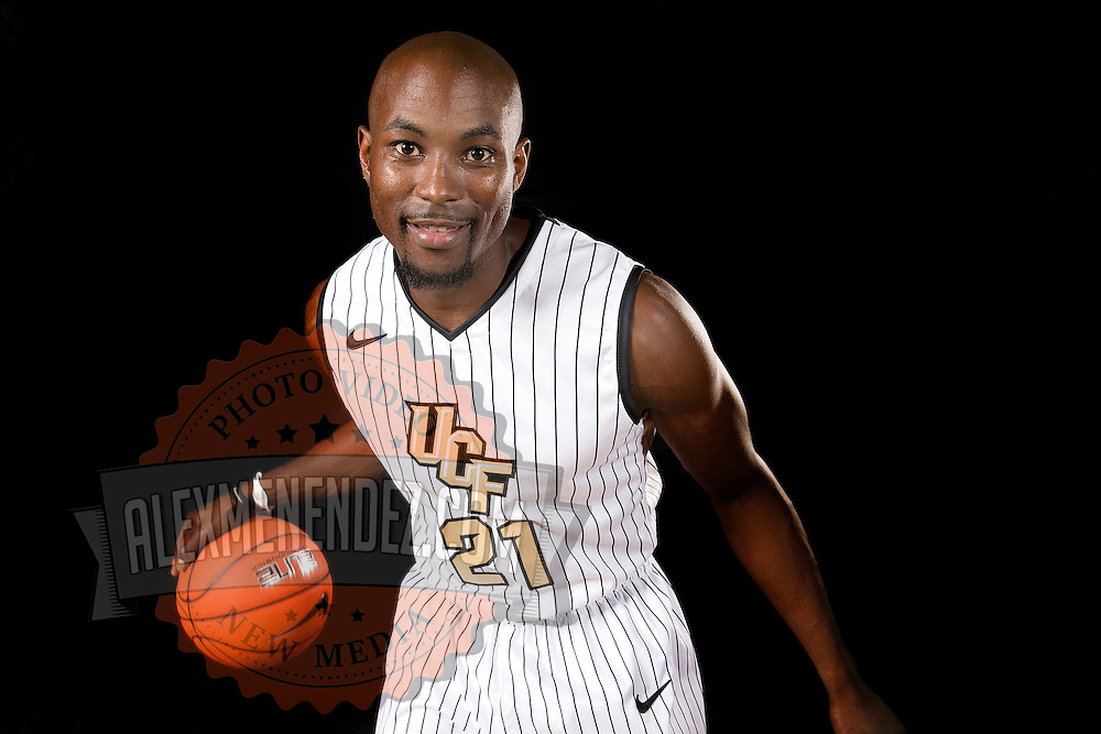 Guard Isaac Lang poses during the Knights media day event at the University of Central Florida CFE Arena on Monday, October 7, 2013 in Orlando, Florida. (AP Photo/Alex Menendez)