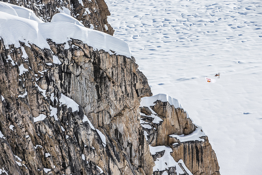 Jon Devore jumps off a large cliff into a spiraling barrel roll while filming for the Unrideables in the Tordrillo Mountains near Anchorage, Alaska on April 27th, 2014.
