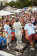 A competitor is weighted covered in grits after rolling around in a pool of instant grits during the grits roll competition at the World Grits Festival April 14, 2012 in St. George, SC. The festival celebrates the southern love for the sticky corn porridge
