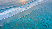 Aerial view of calm waves, breaking at the reef of the local / inhabited island of  Mathiveri, Maldives, Alif Alif Atoll, Indian Ocean