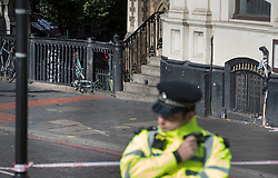 © Licensed to London News Pictures. 05/06/2017. London, UK. Police surround the spot on the southern end of London Bridge where a white van crashed following a terrorist attack in Saturday evening. Three men attacked members of the public  after a white van rammed pedestrians on London Bridge.   Ten people including the three suspected attackers were killed and 48 injured in the attack. Photo credit: Peter Macdiarmid/LNP