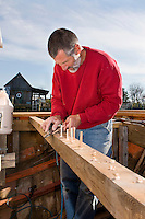 Michael Vlahovich fills in nail holes while working to restore the Skipjack Caleb W. Jones at the Chesapeake Bay Maritime Museum in St. Michael?s, Maryland. The Caleb W. Jones was originally built in 1953 in Reedeville, Virginia