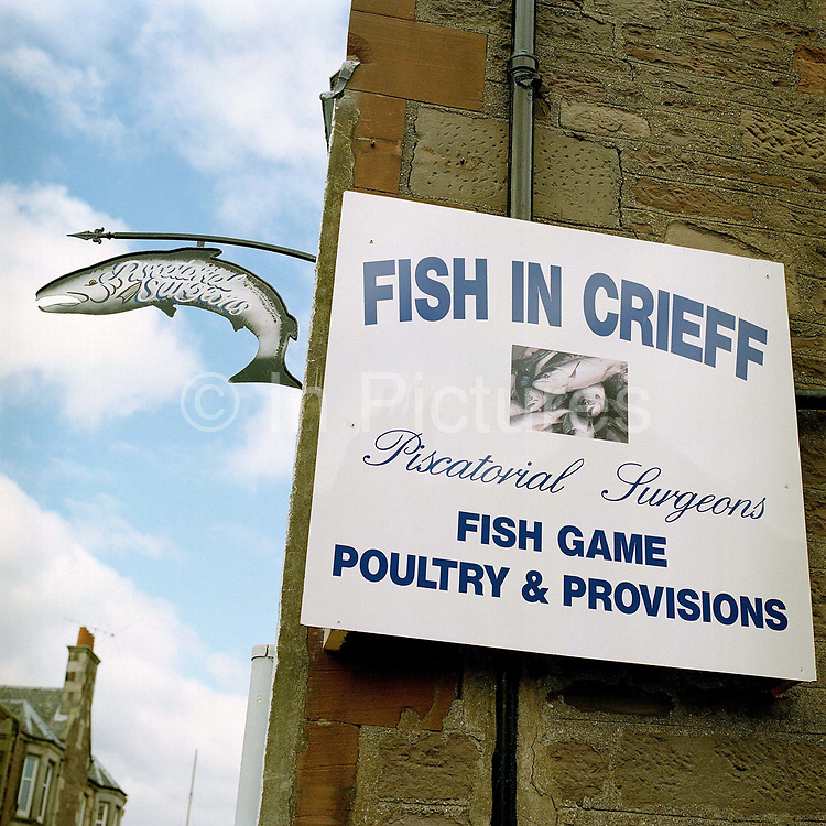 The shop sign of fishmongers Fish in Crieff, Perthshire, Scotland. Owned by experienced fishmonger Willie Little, whose passion for the sea can be tasted at his Little's Restaurant in Blairgowie, these 'piscatorial surgeons' offer a wide range of fresh fish and shellfish bought direct from Scrabster Market in the North of Scotland - from market to plate within 12 hours. The shop also supplies game and poultry, deli produce, and homemade items such as quiches and terrines.