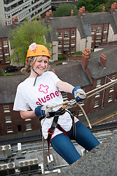 Plusnets Chloe Snelson starts here decent during the Plusnet and Hill Dickinson Charity Abseil 111 feet down the Balance building in Sheffield to raise money for Roundabout and Saint Lukes Hospice on Wednesday <br /> <br /> 11 June 2013<br /> Image © Paul David Drabble<br /> www.pauldaviddrabble.co.uk