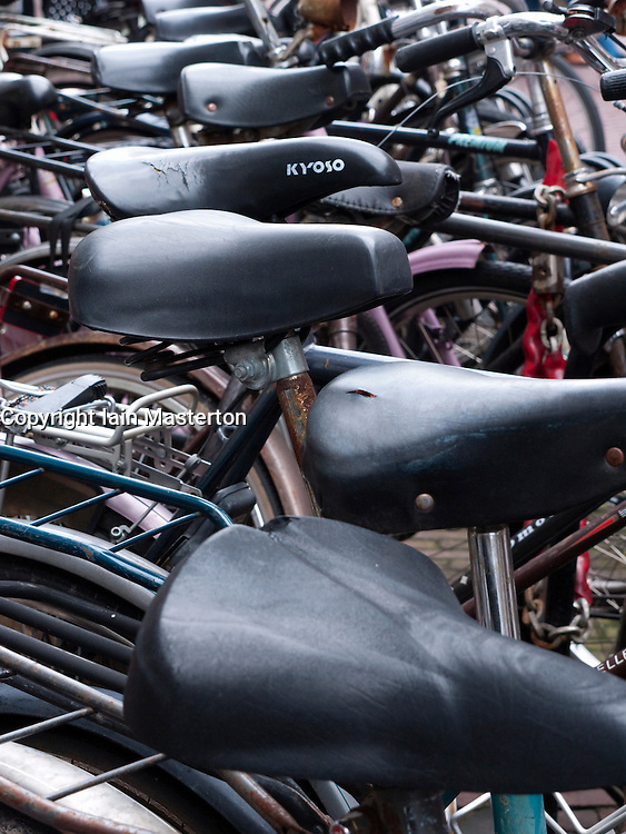 Detail of parked bicycles on street  in Utrecht