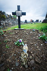 Crosses and small plastic relic at Murrisk Abbey at foot of Crough Patrick, County Mayo, Ireland