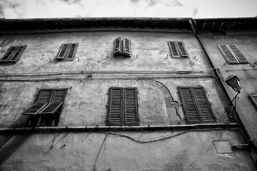 Black and White Photo, Shuttered windows, rustic building, San Quirico d'Orcia, Italy