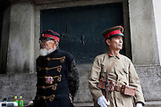 Old men in Imperial era military uniforms at Yasukuni Shrine. On August 15th every year people gather at Yasukuni Shrine to commemorate the end of the Pacific War. Notionally a call for remembrance and continued peace it is also a Mecca for right wing nationalist including  the paramilitary Uyoku Dantai. Tokyo, Japan, August 15th 2009