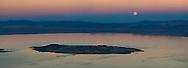 Panorama of full moon rising over Mono Lake at sunset; Mono County; Eastern Sierra; California
