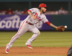 June 9, 2017 - St Louis, MO, USA - Philadelphia Phillies shortstop Freddy Galvis tosses the ball to the second baseman with his glove hand to start a double play in the fifth inning against the St. Louis Cardinals on Friday, June 9, 2017, at Busch Stadium in St. Louis. The Cards won, 3-2. (Credit Image: © Chris Lee/TNS via ZUMA Wire)