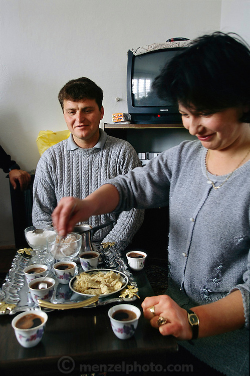 (MODEL RELEASED IMAGE). Ensada Dudo graciously welcomes visitors to her home in Sarajevo with Turkish sweets and cups of Turkish-style coffee on a handcrafted tray. Metalwork is a Sarajevan specialty. Hungry Planet: What the World Eats (p. 51).