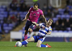 """Queens Park Rangers's Nahki Wells (left) is tackled by Reading's Josh Sims during the Sky Bet Championship match between Reading and Queens Park Rangers. PRESS ASSOCIATION Photo. Picture date:  Tuesday October 2, 2018. See PA story SOCCER Reading. Photo credit should read: Andrew Matthews/PA Wire. RESTRICTIONS: EDITORIAL USE ONLY No use with unauthorised audio, video, data, fixture lists, club/league logos or """"live"""" services. Online in-match use limited to 120 images, no video emulation. No use in betting, games or single club/league/player publications"""