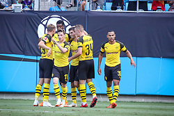 July 22, 2018 - Charlotte, North Carolina, USA - Borussia Dortmund players congratulate Borussia Dortmund midfielder Christian Pulisic (22) after his second goal during an International Champions Cup match at Bank of America Stadium in Charlotte, NC.  Borussia Dortmund of the German Bundesliga beat Liverpool of the English Premier League 3 to 1. (Credit Image: © Jason Walle via ZUMA Wire)