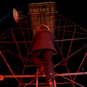 BJ Kirschhoffer climbs the Cape Churchill tower in the black of night to fix the fuel cells that run the wireless network for transmitting back to .Churchill.