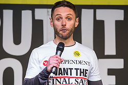 London, UK. 23rd March, 2019. Christian Broughton, Editor of The Independent, addresses a million people taking part in a People's Vote rally in Parliament Square following a march from Park Lane.