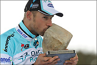 Sykkel<br /> Foto: PhotoNews/Digitalsport<br /> NORWAY ONLY<br /> <br /> ROUBAIX, FRANCE - APRIL 08: BOONEN Tom of Team Omega Pharma - Quickstep with the famous cobblestone of Paris - Roubaix pictured during the podium ceremony of the UCI WorldTour 110th Paris Roubaix cycling race with start in Compiegne and finish in Roubaix on April 8, 2012 in Roubaix, France
