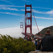 People enjoy Golden Gate Bridge in a fog from Horseshoe bay vista point, San Francisco