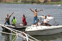 23.07.2015, Giza, EGY, Partyschiff bei Nilfahrt gekentert, im Bild Suche nach Überlebenden. Mit einer Bootsfahrt auf dem Nil feiert eine Partygesellschaft die Verlobung eines Paares. Plötzlich stößt das Boot mit einem Frachter zusammen und kentert. Die meisten Passagiere kommen dabei uns Leben. // People, including relatives, shout slogans against government during a search for victims of a boat collision on the River Nile in the Warraq area of Giza, south of Cairo. At least 15 people drowned when the small boat collided with a barge and capsized on the Nile River near Cairo on Wednesday night, Egypt's interior ministry said in a statement, Egypt on 2015/07/23. EXPA Pictures © 2015, PhotoCredit: EXPA/ APAimages/ Stringer<br /> <br /> *****ATTENTION - for AUT, GER, SUI, ITA, POL, CRO, SRB only*****