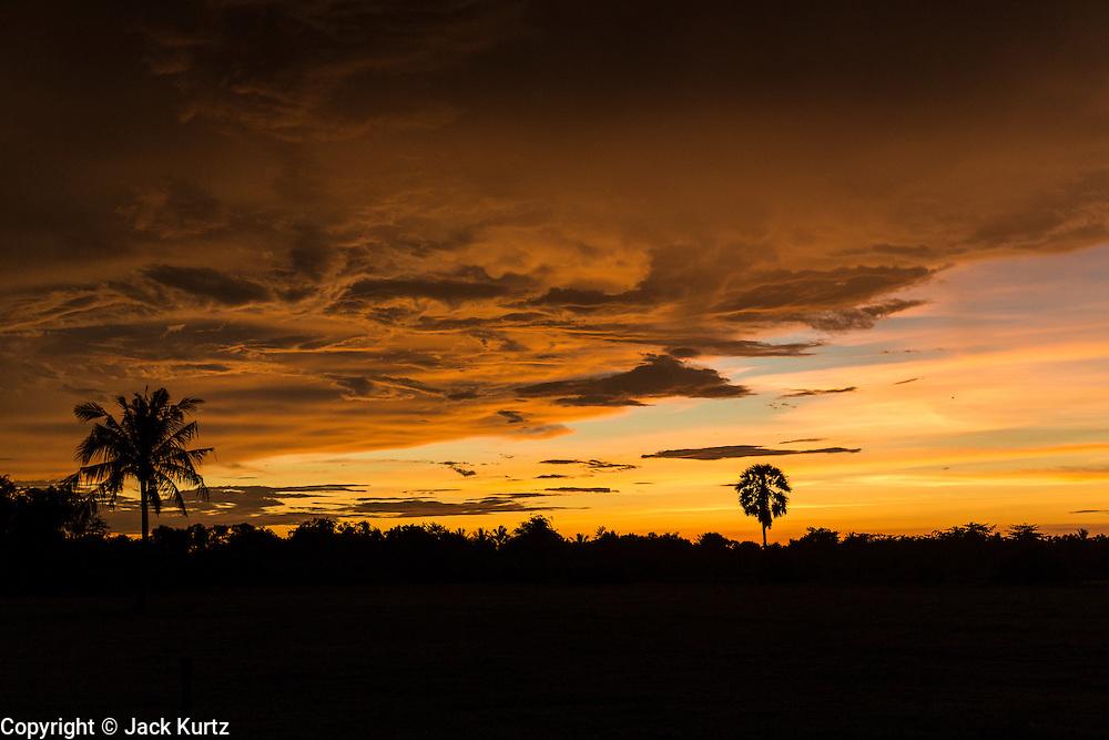 29 JUNE 2013 - BATTAMBANG, CAMBODIA:  The sun sets over a rice field near Battambang, Cambodia.   PHOTO BY JACK KURTZ