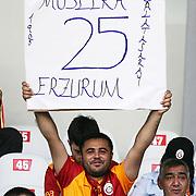 """Galatasaray's Erzurum based supporter showing a flag """"Erzurum 25"""" during their Turkish Super Cup 2012 soccer derby match Galatasaray between Fenerbahce at the Kazim Karabekir stadium in Erzurum Turkey on Sunday, 12 August 2012. Photo by TURKPIX"""