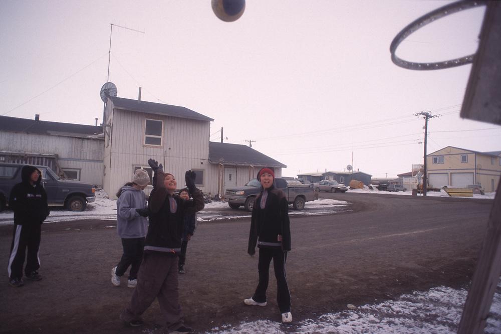 Girls play basketball on the street enjoying the nice weather.<br /> <br /> May 14, 19:45