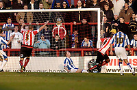 Photo: Leigh Quinnell.<br /> Brentford v Huddersfield Town. Coca Cola League 1. 21/01/2006. Brentfords Lloyd Owusu slots home a goal.