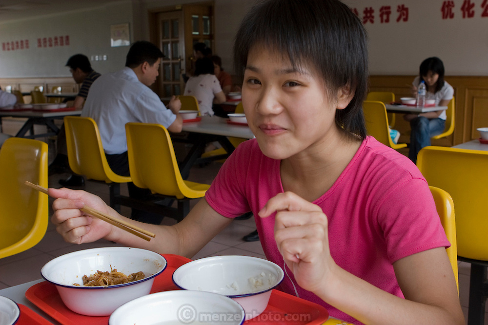 Cao Xiaoli, a professional acrobat, enjoys her lunch at Circusworld Acrobat Center's cafeteria in Shanghai, China. (Featured in the book What I Eat: Around the World in 80 Diets.) The caloric value of her day's worth of food on a typical day in June was 1700 kcals.  She is 16 years of age; 5 feet, 2 inches tall; and 99 pounds. She started her career as a child, performing with a regional troupe in her home province of Anhui. Now she practices five hours a day, attends school with the other members of her troupe, and performs seven days a week. She says what she likes best about being an acrobat is the crowd's reaction when she does something seemingly dangerous.