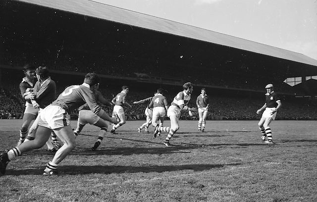 Cork goalie Billy Morgan weaves his way through his backs and finds a good clearance during the All Ireland Senior Gaelic Football Final Cork v Meath in Croke Park on the 24th September 1967. Meath 1-9 Cork 0-9.