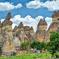 Cappadocia. Turkey. View of mushroom shaped fairly chimneys with multiple stems and caps, some housing chapels in Pasbag or Monks valley. Monks Valley is famous for having some of Cappadocia's finest mushroom shaped fairly chimneys in which Monks hollowed out and lived in.