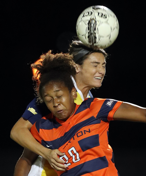 UC Irvine defender Kelsey Texeira (22) and Cal State Fullerton midfielder Jannelle Garcia (20) battle for the ball during the Big West Conference semi-final playoff game between the Cal State Fullerton University Titans vs. UC Irvine Anteaters at George Allen Field on November 3, 2016.<br /> <br /> Photo by Darren Yamashita / Sports Shooter Academy