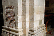 a very tick pillar in a cathedral church Toulouse France
