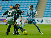 Photo: Leigh Quinnell.<br /> Coventry City v Plymouth Argyle. Coca Cola Championship.<br /> 03/12/2005. Coventrys Gary McSheffrey can't find a way Past Plymouths Matthias Doumbe and Paul wotton.