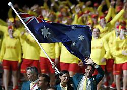 Australian flag bearer Mark Knowles leads the team out during the Opening Ceremony for the 2018 Commonwealth Games at the Carrara Stadium in the Gold Coast, Australia. PRESS ASSOCIATION Photo. Picture date: Wednesday April 4, 2018. See PA story COMMONWEALTH Ceremony. Photo credit should read: Martin Rickett/PA Wire. RESTRICTIONS: Editorial use only. No commercial use. No video emulation