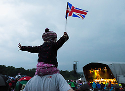 © Licensed to London News Pictures.22/08/15<br /> Castle Howard, North Yorkshire, UK. <br /> <br /> ELLA KITTON, 3, from York sits on her fathers shoulders to watch a performance during the 25th anniversary of the Castle Howard Proms event near York. The theme of the event this year is a commemoration of the 75th anniversary of the Battle of Britain and the 70th anniversary of VE day and brings an evening of classic musical favourites celebrating Britishness to the lawns of Castle Howard.<br /> <br /> Photo credit : Ian Forsyth/LNP