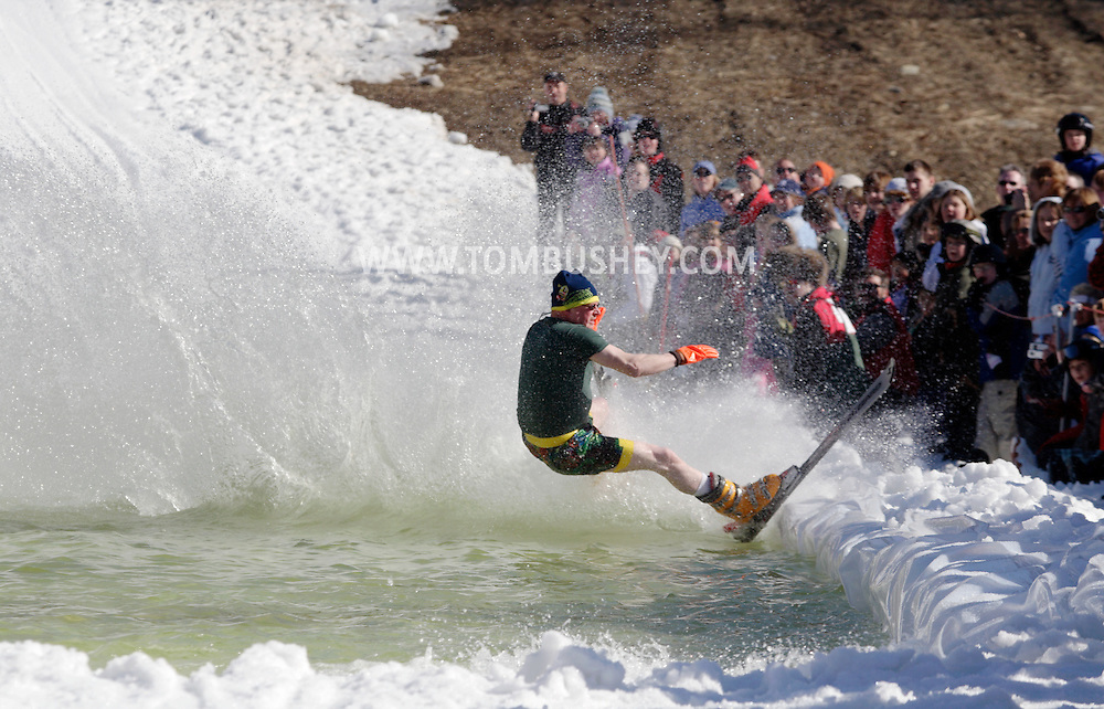 Warwick, NY - A skier falls while trying to cross the water at the end of a run during the Spring Rally at Mount Peter in Warwick on March 29, 2008.