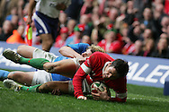 James Hook of Wales dives over for his 1st try. RBS Six nations championship 2010, Wales v Italy at the Millennium Stadium in Cardiff  on Sat 20th March 2010. pic by Andrew Orchard, Andrew Orchard sports photography,