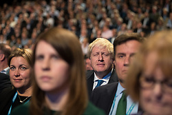 © Licensed to London News Pictures  . 03/10/2017 . Manchester , UK . BORIS JOHNSON in the audience at the conference , ahead of his keynote speech , on day three of the Conservative Party Conference at the Manchester Central Convention Centre . Photo credit : Joel Goodman/LNP